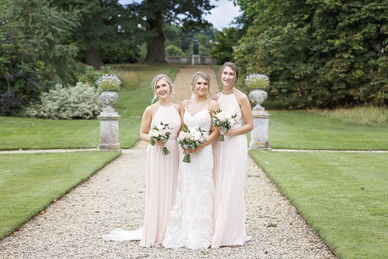 Bride and bridesmaids in the grounds of Woburn Sculpture gallery