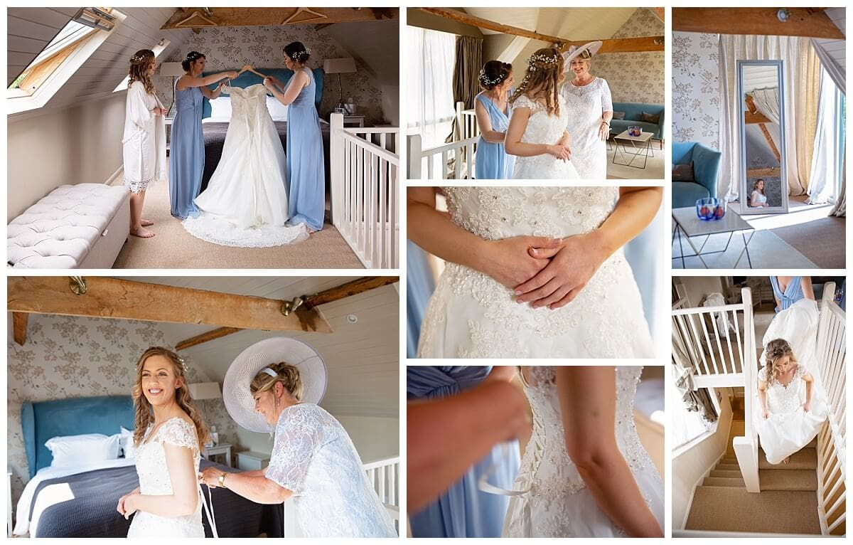 Bride putting on her wedding dress at South Farm