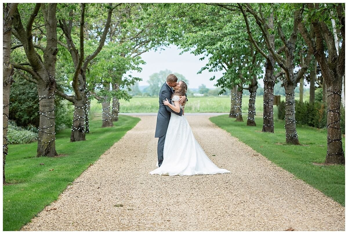 Bride and Groom in the driveway of South Farm