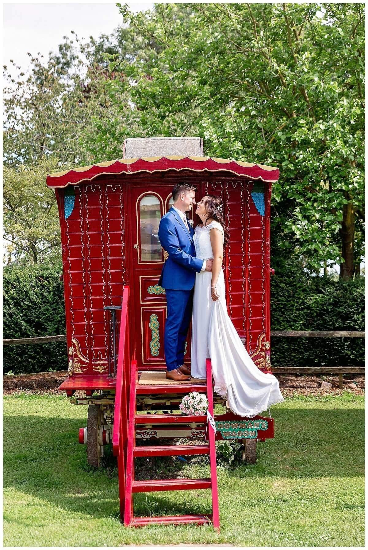 Bride & Groom on Gypsy Caravan at South Farm