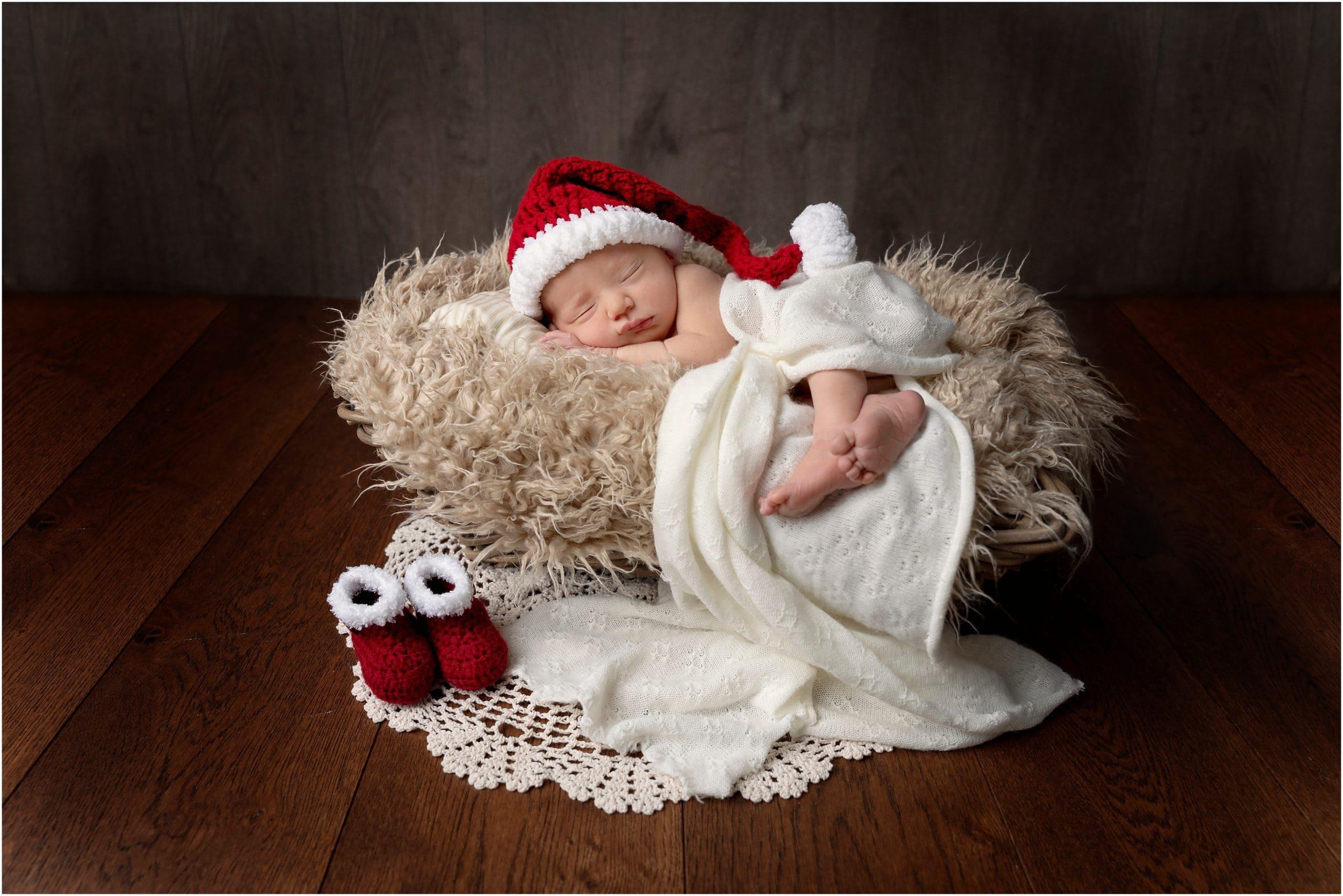 Newborn in a santa hat