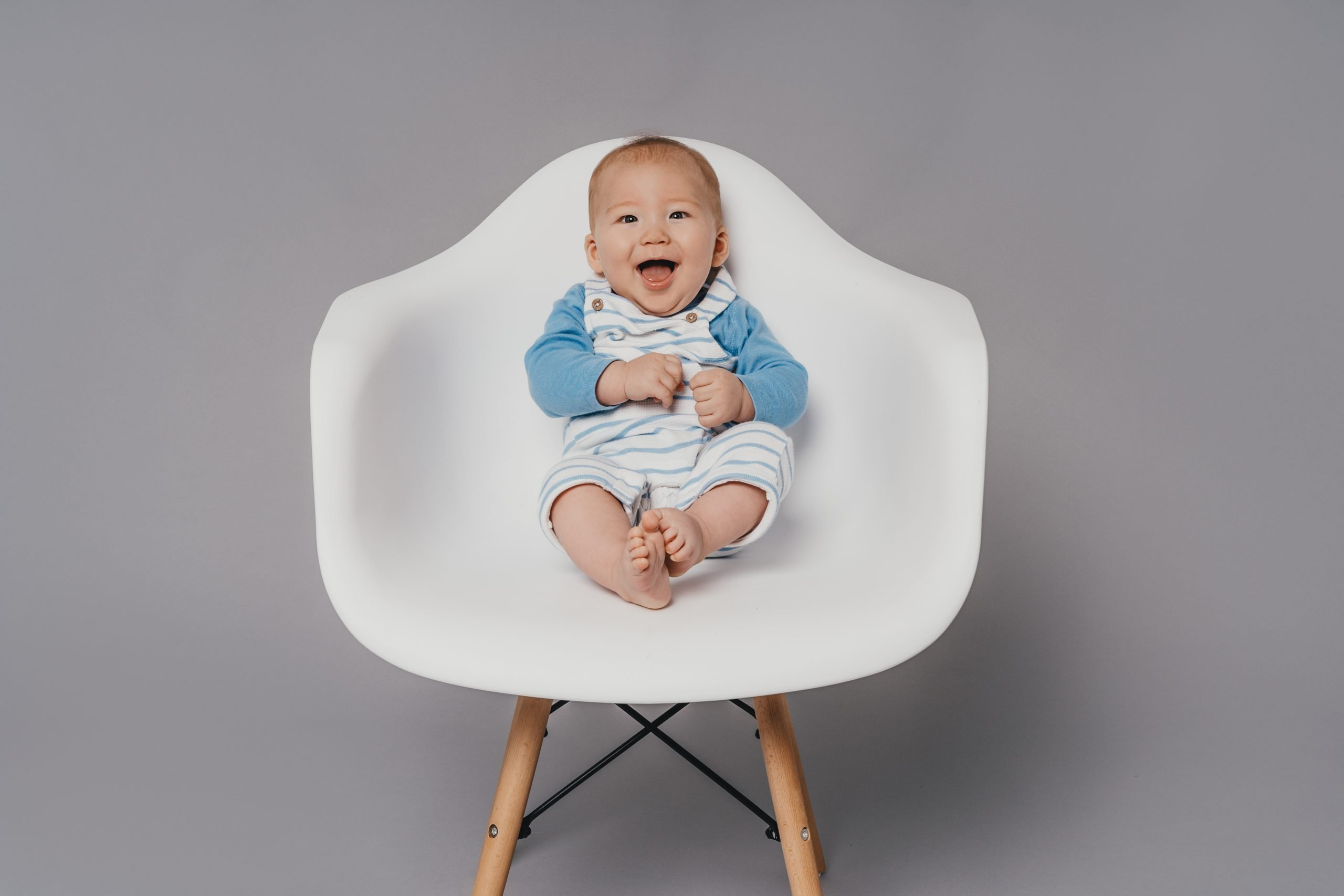 Sitter Baby in a white Chair