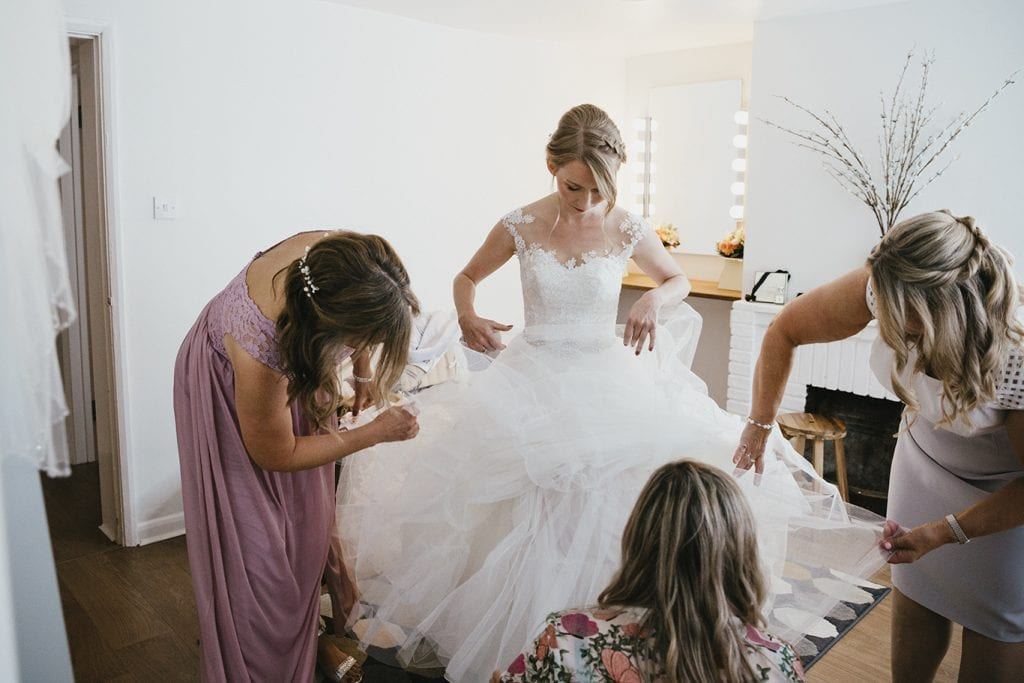 Bride at Granary Estates getting her dress on