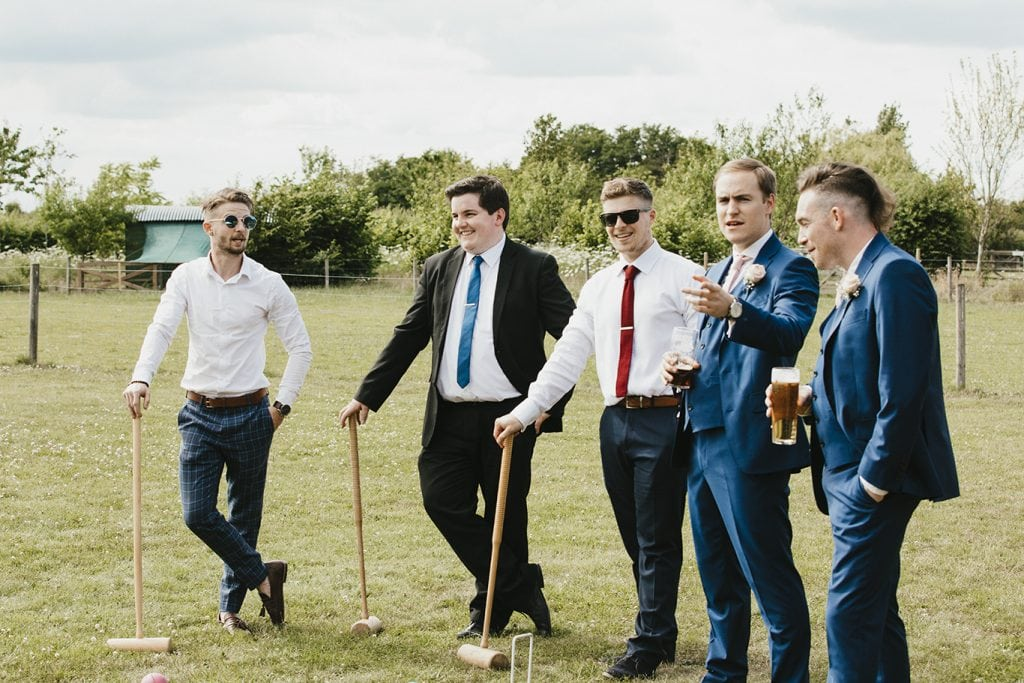 friends playing croquet at a wedding