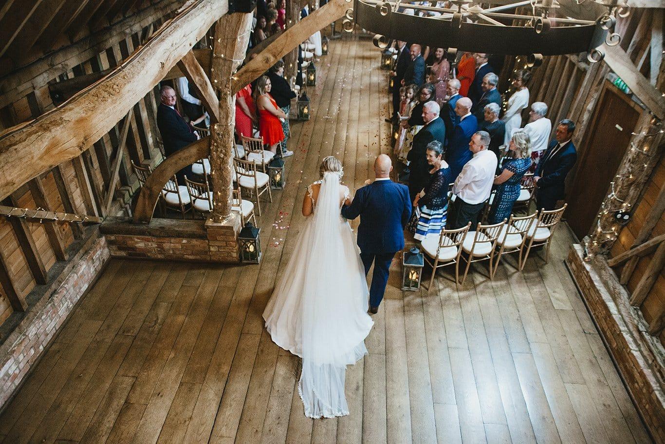 Bride entering the Rickety Barn at Bassmead Manor Barns