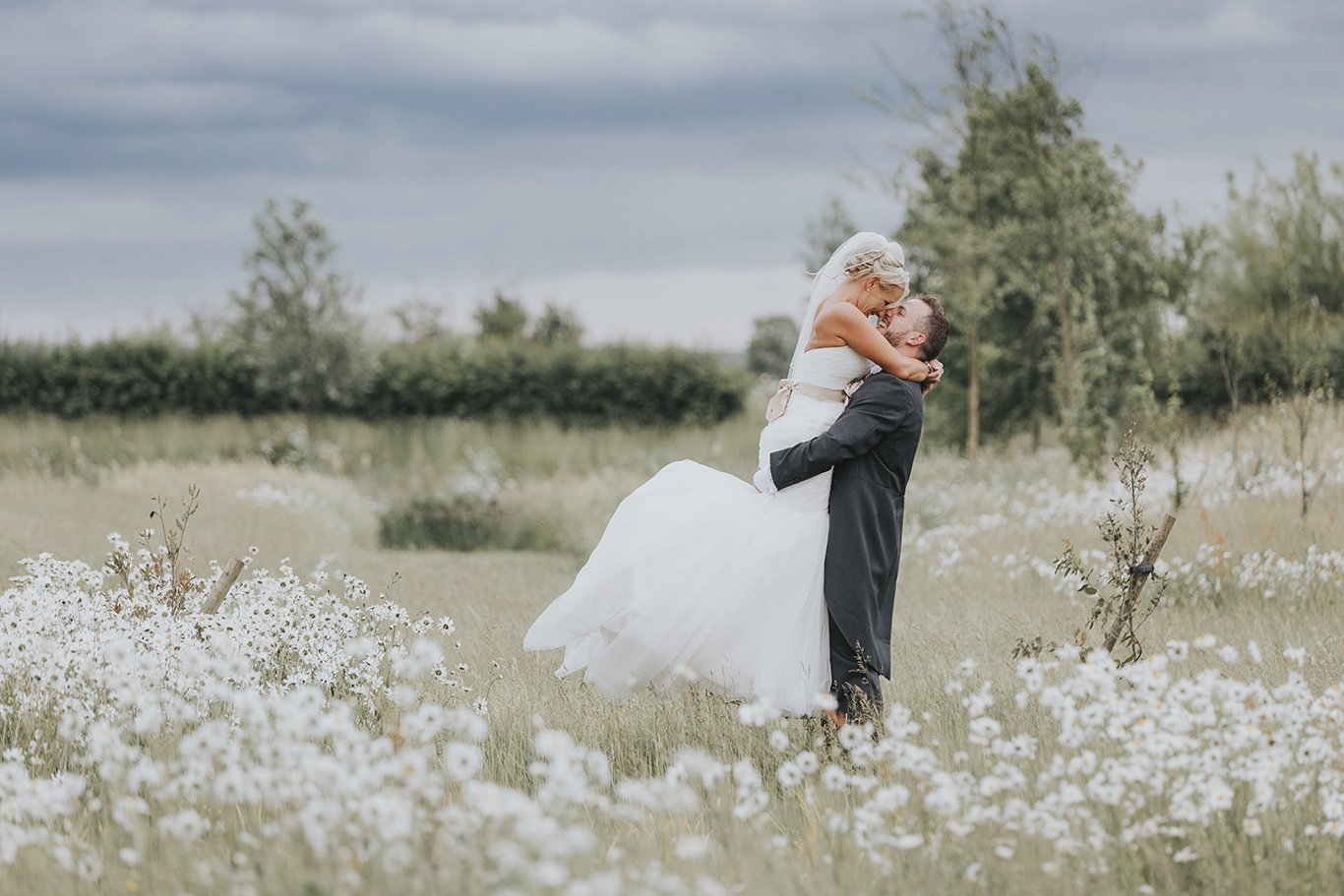 Bride and Groom in wild flowers at South Farm