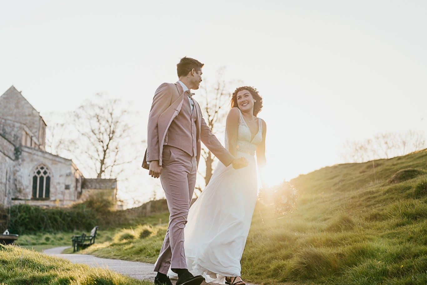 Couple by church at sunset