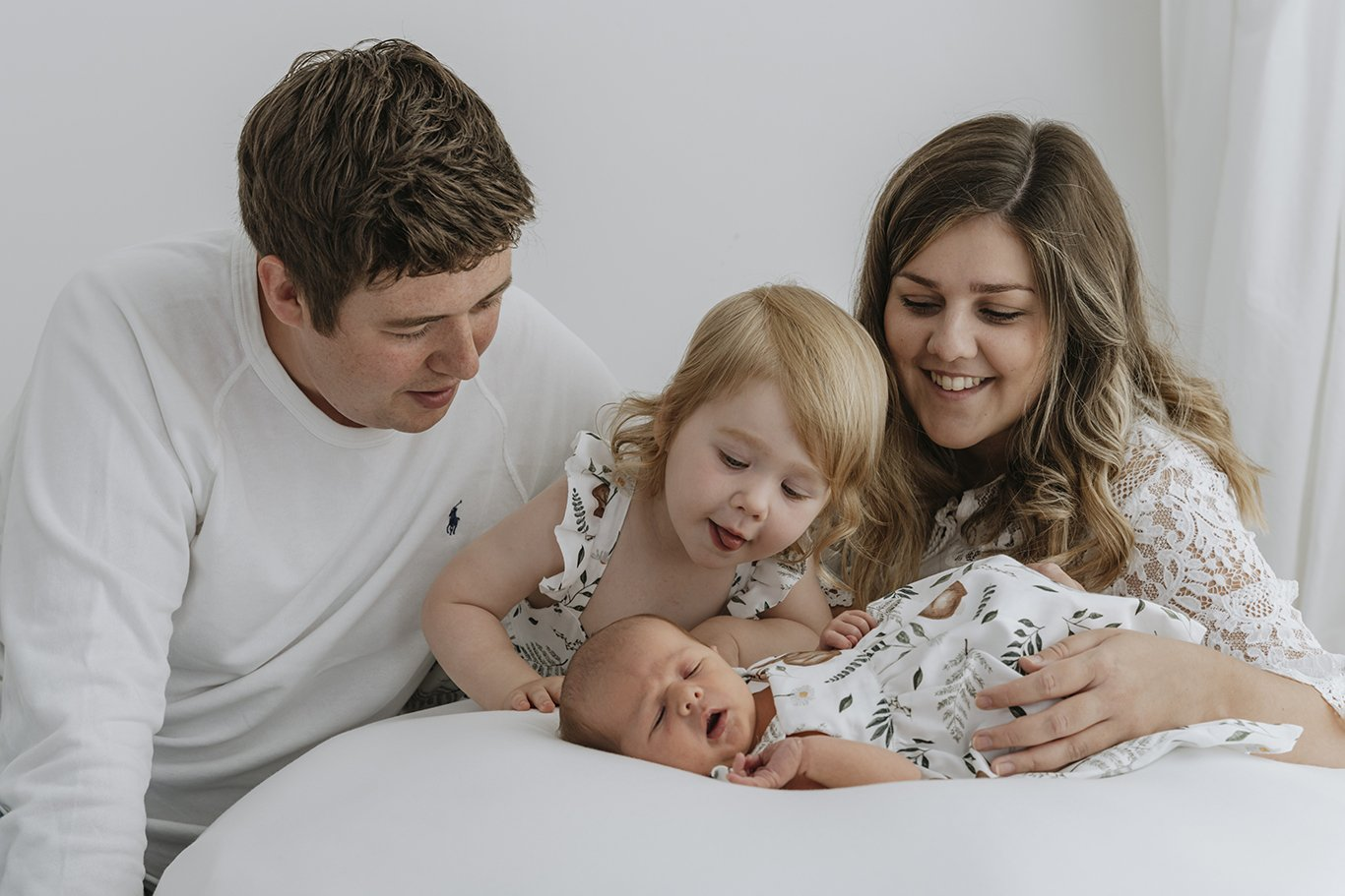 Family looking at a baby